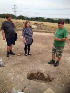 Keith points out pit on archaeological site