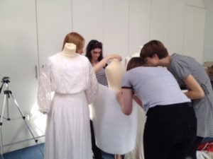 hitchin girlsschool pupils practising padding the mannequins for display